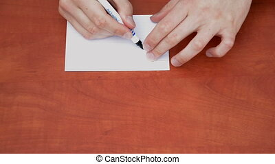 Handwritten word Lose on white paper sheet