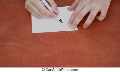Handwritten word Off on white paper sheet