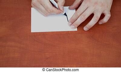 Handwritten word Please on white paper sheet