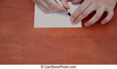 Handwritten word Right on white paper sheet