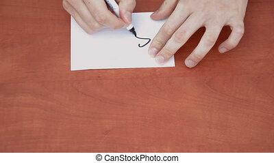 Handwritten word Sale on white paper sheet