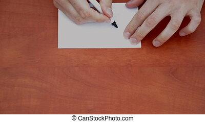 Handwritten word Solution on white paper sheet