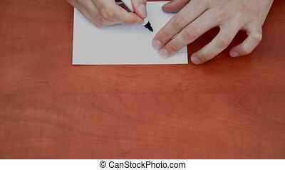 Handwritten word Solve on white paper sheet