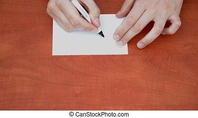 Handwritten word Stop on white paper sheet