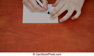Handwritten word Thanks on white paper sheet
