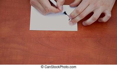 Handwritten word Urgent on white paper sheet
