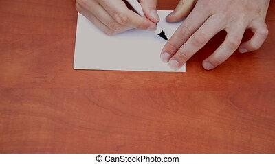 Handwritten word Wait on white paper sheet