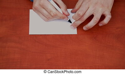 Handwritten word Welcome on white paper sheet