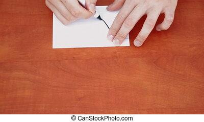Handwritten word Win on white paper sheet