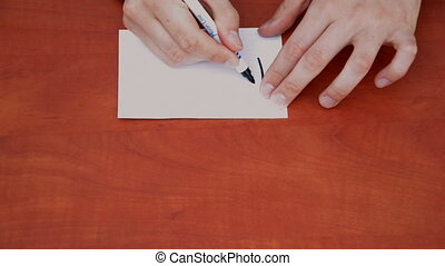Handwritten words How Much on white paper sheet