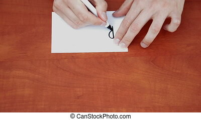 Handwritten words Right Now on white paper sheet