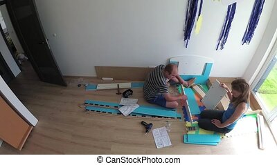 Handy dad constructing new bed for his son. Static timelapse shot