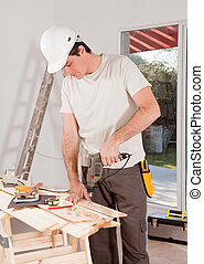 Handy Man Drilling - A carpenter drilling with a hand drill...