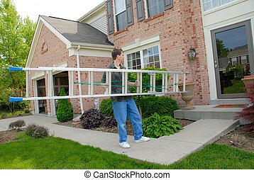 Handy Man Ladder - a man carrying an aluminum ladder toward ...