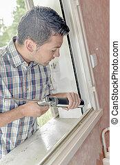 handy man putting in window