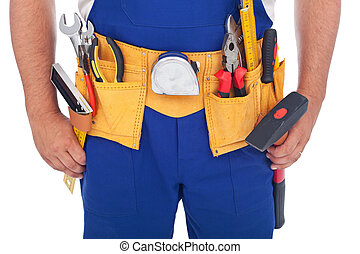 Handy man with lots of tools - closeup on belt