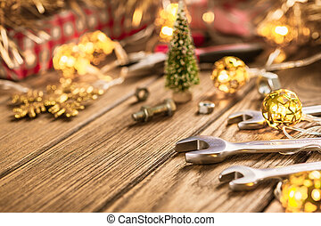Handy Tools on Christmas time background concept. Wrenches and handy tools with Christmas ornament decoration on a rustic wooden table.