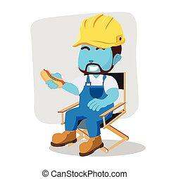handyman break with holding hot dog