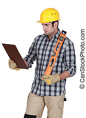 Handyman checking his clipboard.