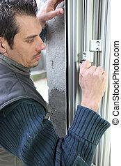 Handyman fitting new windows