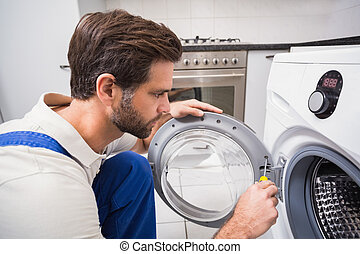 Handyman fixing a washing machine