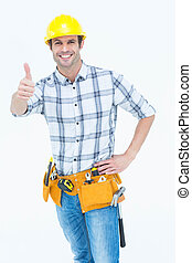 Handyman gesturing thumbs up sign - Portrait of happy...