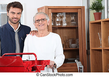 Handyman helping out a senior woman at home