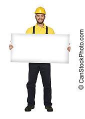 handyman hold white board - young caucasian handyman hold...