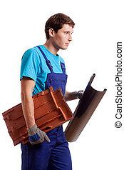 Handyman holding a gutter