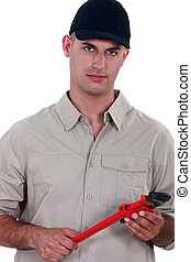 Handyman holding a pipe wrench
