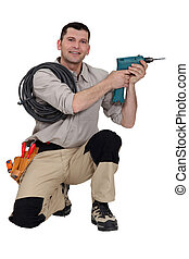 Handyman holding a power tool