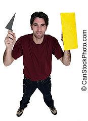 handyman holding trowels