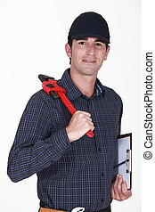 Handyman holding wrench and clip-board
