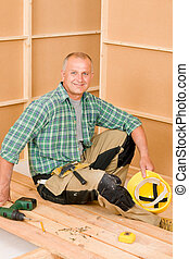 Handyman home improvement wooden floor screwdriver
