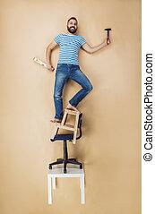 Handyman in a dangerous pose