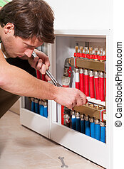 Handyman in boiler room