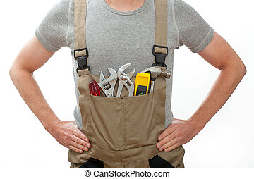 Handyman in overalls - Young and strong handyman rady to...