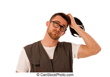Handyman in work clothing scratching on head, looking up,...