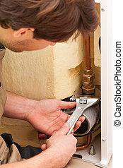 Handyman mending pipes