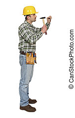 handyman on duty with hammer and nail isolated on white