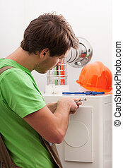 Handyman repairing central heating