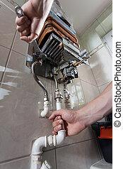 Handyman repairing gas water heater