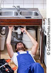 Handyman repairs sink