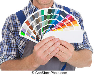 Handyman Showing Fanned Color Swatches