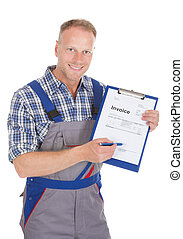 Handyman Showing Invoice On Clipboard - Portrait of smiling...