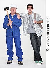 Handyman stood with teenage son