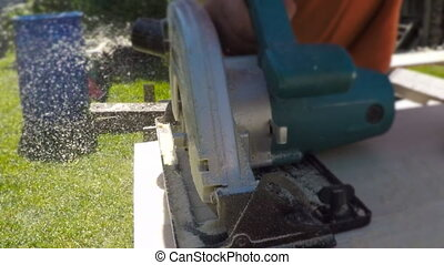 Handyman using hand-held saw. - Handyman using hand-held saw...