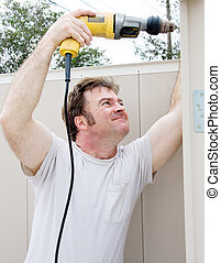 Handyman Using Power Drill