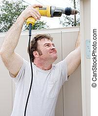 Handyman Using Power Drill