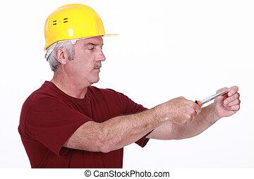 Handyman using screwdriver